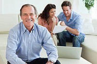 Financial advisor sitting in living room with couple