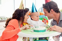 Parents and baby celebrating first birthday (thumbnail)