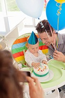 Parents celebrating baby's first birthday
