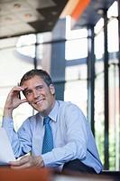 Businessman sitting with paperwork