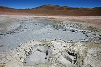 Mud lakes and steam pools with boiling mud in geothermal field Sol de Mañana, Altiplano, Bolivia