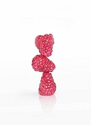 Three raspberries balancing on top of each other