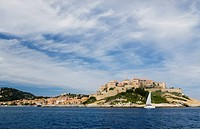 France, Corsica. Cirrus clouds above old city at Calvi within the walls of the historic Venetian fortress.