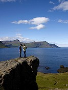 Couple standing on cliff, Skalanes, Eastern, Iceland