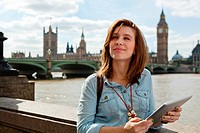 Young woman using a digital tablet in London (thumbnail)