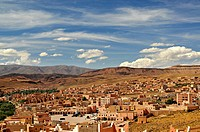 Village and palm plantations with the Atlas Mountains in the Background, Morocco