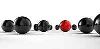A set of black and red balls as concept for teamwork, isolated on white background