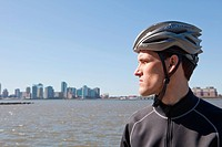 Man in cycling gear looking at view