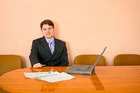 Businessman at a table with laptop