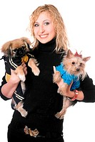 Portrait of smiling pretty young blonde with two dogs