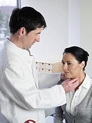 Germany, Hamburg, Doctor examining patient in clinic