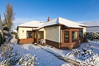 Bungalow in winter snow, Wirral, Merseyside, England
