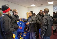 Detroit, Michigan - Members of the Associated Food and Petroleum Dealers distribute free Thanksgiving turkeys to low-income families at the New Greate...