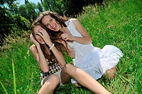 Two happy teen friends girls enjoying together outdoors in nature