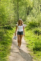 young Pre_Teen girl goes in the Old Growth forest for a walk in a barefoot way