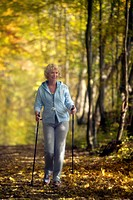 elderly woman , nordic walking elderly woman , nordic walking