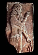 Priest with a branch of pomergranate tree. Detail of a relief from the palace of Assyrian king Sargon II. Assyrian Art . Limestone. The Oriental Arts....