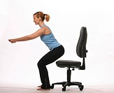 Young blond woman getting up from a bureau chair _ circulation