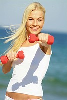 Young woman working out with two red bar_bells