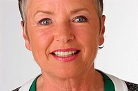 Portrait older woman smiles into the camera