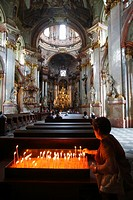 Faithful inside St  Nicholas Church in the Little Quarter, Prague, CZ