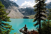 Canada, BC, Mount Curry.  Hiker looking out at the Upper Joffre Lake on the Joffre Lakes Trail