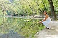 Young cute woman in a lake
