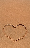 Heart drawing in sand, with copy_space