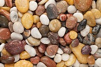 colorful river pebbles with water drops