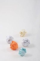colorful balls of paper on table
