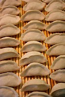 a close_up view of rows of dumplings