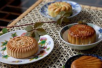 a close_up view of mooncakes in a plate