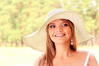 Beautiful young woman wearing white hat
