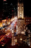The Old Water Tower lit up at night looking south down Michigan Avenue from Pearson Street Photographed from above