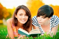 Two girl read a book