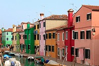Colourfully painted houses on a canal Burano, Venice, Veneto, Italy, Europe