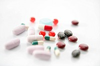 pills over white, health or suicide