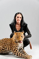 Mature woman and spotty leopard