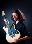 Guitar player against the dark background