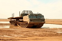 A powerful army truck all_terrain vehicle. Close_up. Day.