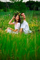 pair of man and woman. wreath of flowers on the head of the girl. outdoor shot