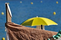 Parasol and boat, Tossa de Mar, Costa Brava, Catalonia, Spain, Europe