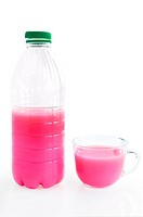Bottle and a cup with a pink drink