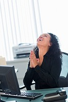 Business woman using computer and laughing
