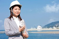 Young Businesswoman with Blueprint and Hardhat