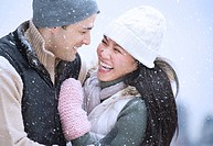 Couple wearing warm clothing having fun outside