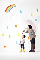 Mother and Son in Rain Looking At Rainbow