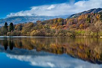 England, Cumbria, Coniston Water. Lakeland hills reflected upon the still face of Coniston Water in the Lake District National Park