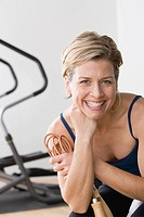 Portrait of smiling woman in gym