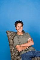 Portrait of teenage boy 16_17 sitting in chair